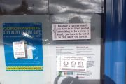 GP practice door plastered with anti-vaccine messages ahead of clinic